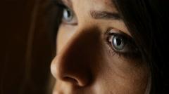 Sad woman eyes in the night Stock Footage