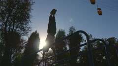 Athlete training performs a handstand at muscle outside. Workout sport lifestyle Stock Footage