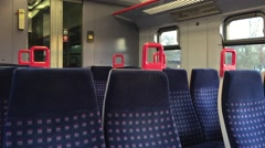 An empty shot of a train with seats Stock Footage