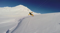 A young man snow kiting on a snowboard. Stock Footage