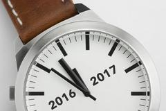 Watch with analog conceptual visualization of the turn of the year. Stock Photos