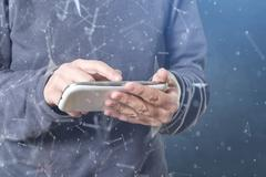 The cyber criminal person using a smart phone in deep web cyberspace Stock Photos
