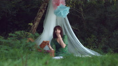4k Natural Shot of a Woman Enjoying Food in her Forest Picnic Shelter Stock Footage