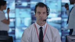 4K Surveillance officer making a video call in control room Stock Footage