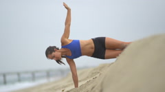 A young woman working out on the beach, slow motion. Stock Footage