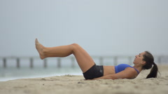 Woman working out on the beach, slow motion. Stock Footage