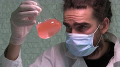 A Young Scientist Is Examining Chemical Reaction In The Flask Stock Footage