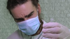 A Scientist In A Face Mask And Latex Gloves Is Holding A Flask Stock Footage