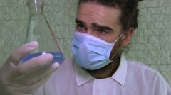 A Laboratory Assistant Is Analising Contents Of A Blue Liquid In A Flask Stock Footage