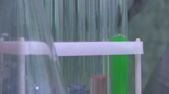Carrying Out Chemical Analyses Using A Pipet and Test Tubes. Close Up Stock Footage
