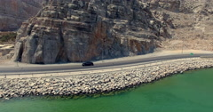 Following Mercedes on coastal road Musandam Sultanate of Oman Stock Footage