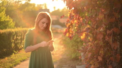 Young woman uses a smartphone Stock Footage