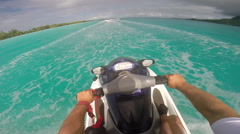 POV of man riding a personal watercraft in the lagoon around Bora Bora island in Stock Footage
