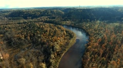 Flying over river and golden autumn forest. Sigulda, Latvia Stock Footage