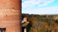 Flyin near Ruins of Turaida castle tower on springtime, Sigulda, Latvia Stock Footage