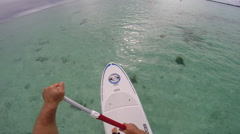 POV of a man sup stand-up paddle boarding in the lagoon around Bora Bora island Stock Footage
