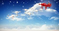 Composite image of mini drones pulling chirstmas sledge with gift Piirros