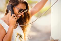 Young stylish woman at telephone box. phone talk retro style. Stock Photos