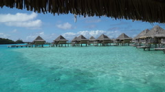 Overwater bungalows at the InterContinental Hotel, Bora Bora island, French Poly Stock Footage