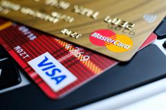 Plastic payment Master Card and Visa macro on the laptop keyboard Stock Photos