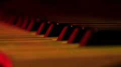 Closeup Electric Piano Keys under Flashes of Colourful Lights Stock Footage