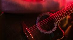 Closeup Guitarist Plays Guitar in Night Bar under Light Flashes Stock Footage