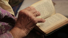 Elderly Woman Flipping A Bible Stock Footage