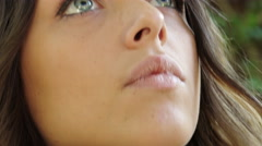 Daydreaming young woman with blue eyes side portrait with Steadicam  Stock Footage