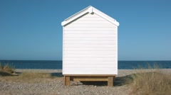 Single Beach hut, Findhorn Beach, Moray Stock Footage