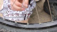 Teenage boy working on his mountain bike. Stock Footage