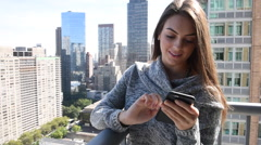Young millennial beautiful happy busy woman girl outside texting on cellphone Stock Footage