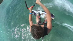 A young man kiteboarding off the island of Tobago. Stock Footage