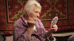 Old Woman Combing Her Hair At Home Stock Footage
