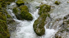 Closeup view to the water stream of mountain river in Austrian alps with zooming Stock Footage