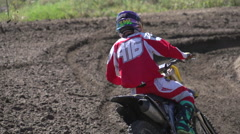 A young man riding a motocross dirt bike, super slow motion. Stock Footage