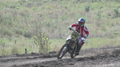 A young man riding a motocross dirt motorcycle, super slow motion. Stock Footage