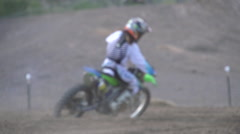 A teenage girl riding a motocross dirt motorcycle , super slow motion. Stock Footage