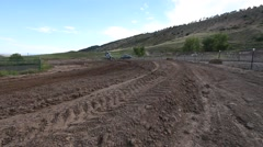 A teenage girl riding a motocross dirt motorcycle. Stock Footage