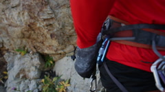 A young man reaching into his chalk bag before rock climbing. Stock Footage