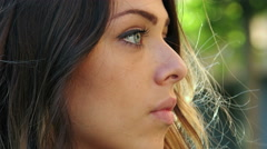 Beautiful young woman looking into the camera sadly: pensive sad woman portrait  Stock Footage