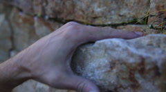 Close-up of a rock climbers hand as he grips the mountainside. Stock Footage