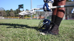 Lacrosse player picking up lacrosse stick. Stock Footage