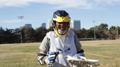 Portrait of a young man playing lacrosse, slow motion. Arkistovideo