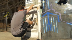 A man with a beard using a wall and urban environment to work out, slow motion. Stock Footage