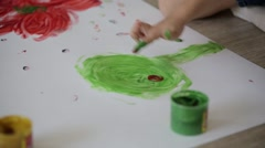 Two little girls draw with finger paints Stock Footage