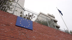 Eu Sign Hanging on a High Fence Stock Footage