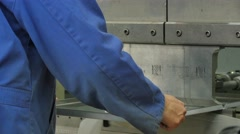 A worker is preparing a heavy steel processing machine in a factory, 4K Stock Footage