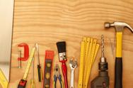 Assorted work tools on wood Stock Photos