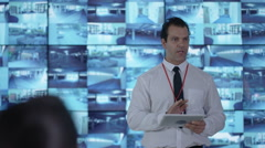 4K Security officer communicating with staff in observation control room Stock Footage
