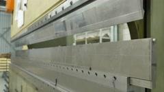 Folding stainless steel in a heavy machine in a factory, 4K Ultra HD Stock Footage
